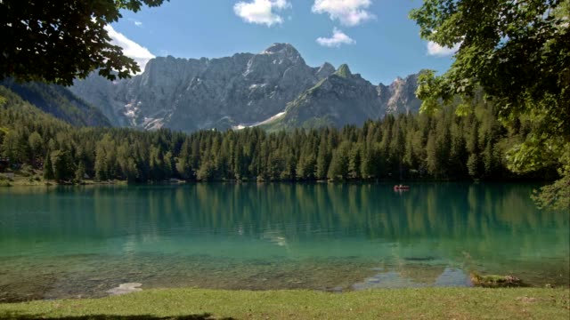 LD Lake surrounded by spruce trees and the mountains