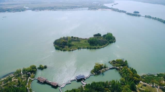 lake taihu and wuxi city - liyao xie stock videos & royalty-free footage