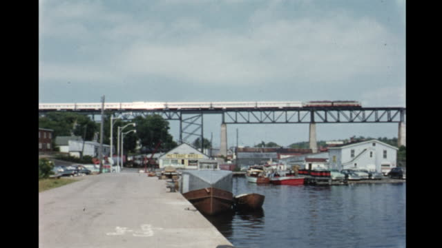 stockvideo's en b-roll-footage met 1955 montage lake, train on railroad bridge / parry sound, ontario, canada - ontario canada