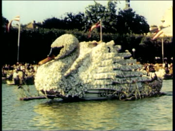 vidéos et rushes de lake traun - traunsee, austria picturesque scenery surrounding lake / boats decorated for traditional festival - including swan boat / people in... - autriche