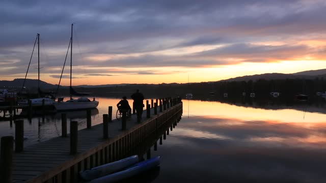 lake windermere at sunset, ambleside, lake district, uk with a disabled woman in a wheelchair. - persons with disabilities stock videos & royalty-free footage