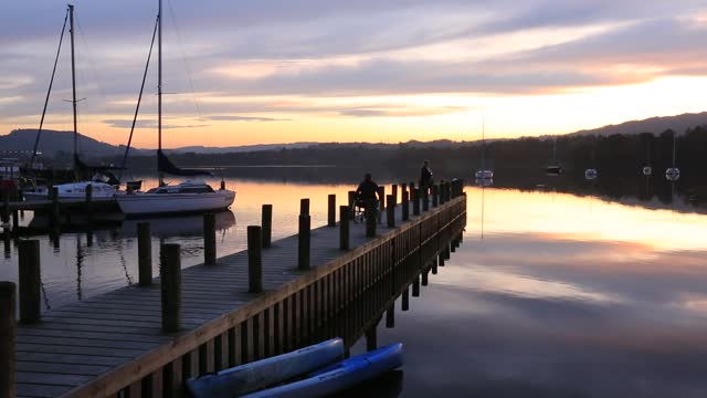 lake windermere at sunset, ambleside, lake district, uk with a disabled woman in a wheelchair. - disability stock videos & royalty-free footage