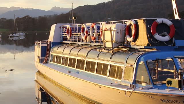 lake windermere at sunset with a tourist boat looking towards bow fell. - passenger ship stock videos & royalty-free footage