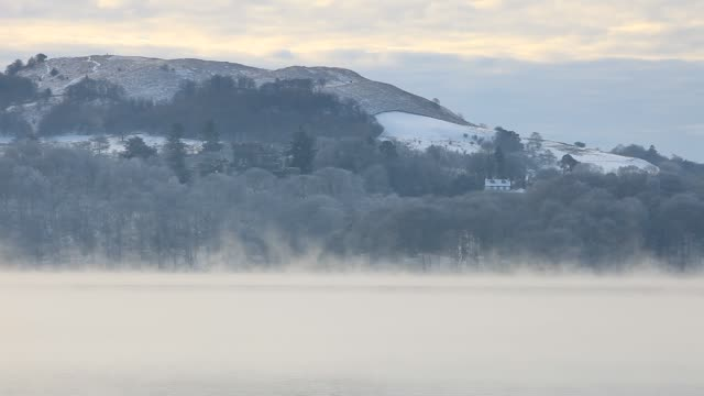 lake windermere in the lake district at sunrise during the december 2010 cold snap, with temperatures below minus 10. - snow stock videos & royalty-free footage
