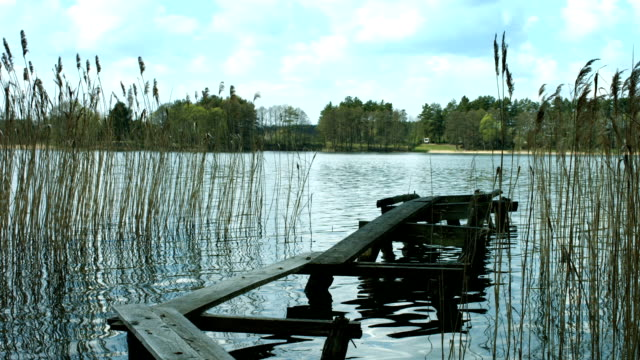 stockvideo's en b-roll-footage met lake with a small pier. - pier