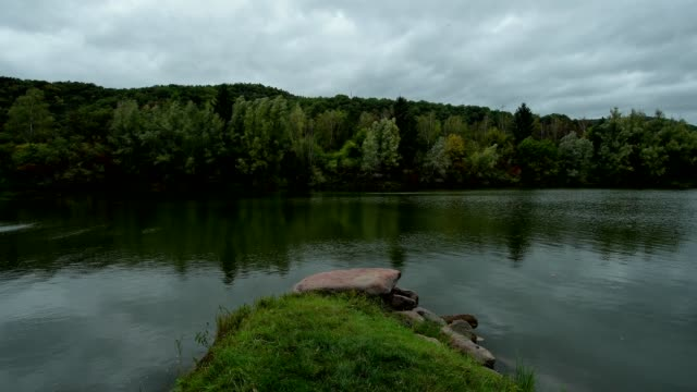 lake with cloudy sky on windy autumn day, mondfeld, wertheim, main-tauber-kreis, baden-württemberg, germany - baden württemberg stock videos & royalty-free footage