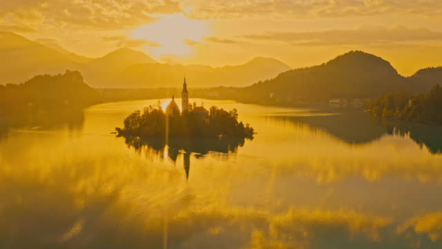 aerial ws lake with island. - slovenia stock videos & royalty-free footage