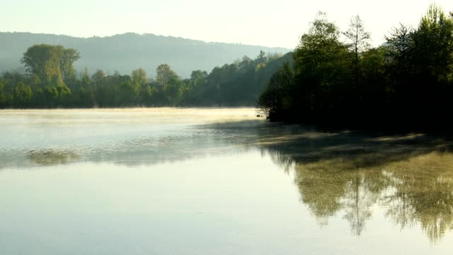 Lake with morning haze in spring, Freudenberg, Baden-Wurttemberg, Germany