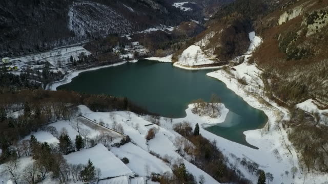 Lake with Snow in the Alps Aerial View