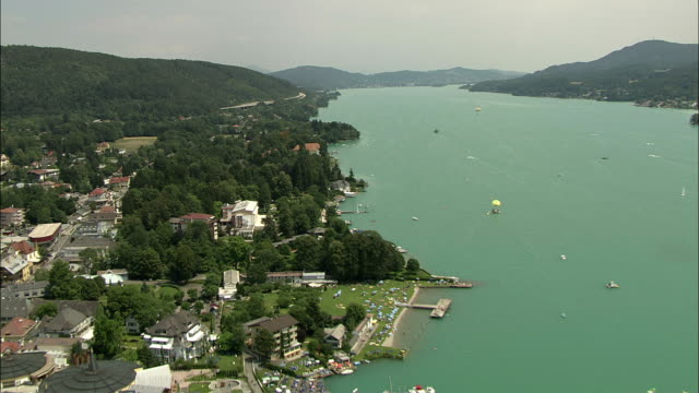 aerial lake woerthersee, carinthia, austria - carinthia stock videos & royalty-free footage