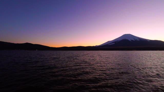 lake yamanaka and mt fuji at dusk - japan videos stock videos and b-roll footage