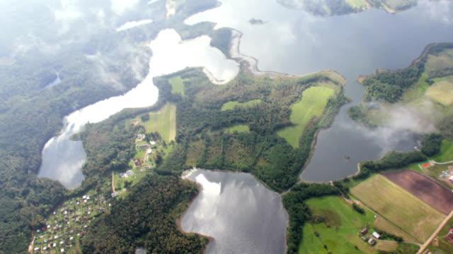 vídeos y material grabado en eventos de stock de lakes and forest through clouds - poland