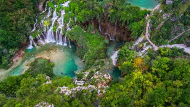 aerial: lakes and waterfalls at plitvice lakes national park - rainforest stock videos & royalty-free footage