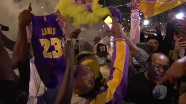 lakes fans celebrate outside staples center following the lakers' game 6 win that clinched the franchise's recordtying 17th championship in los... - staples centre stock videos & royalty-free footage