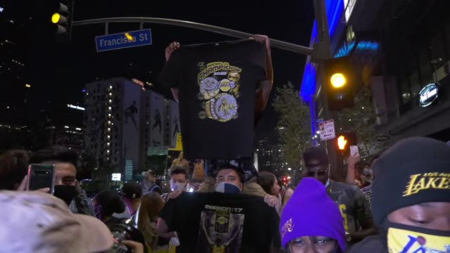 lakes fans celebrate outside staples center following the lakers' game 6 win that clinched the franchise's record-tying 17th championship, in los... - franchising stock videos & royalty-free footage