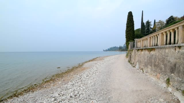 lakeside in the morning, garda, lake garda, lago di garda, veneto, italy - lago stock videos & royalty-free footage