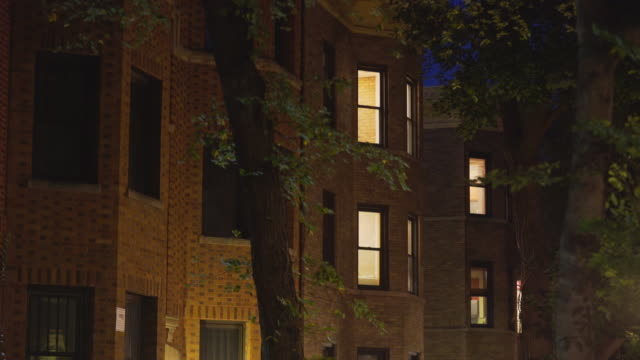 lakeview apartments night exterior - apartment stock videos & royalty-free footage