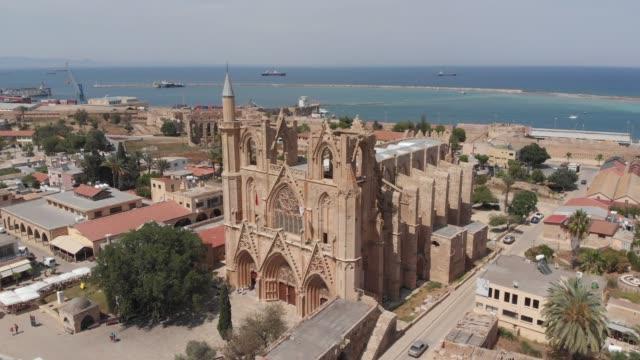 vídeos y material grabado en eventos de stock de mezquita de lala mustafa pasha (catedral de san nicolás) en gazi magosa (famagusta), chipre - liubliana
