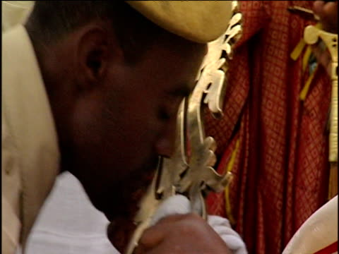 lalibela cross is passed through crowd as people kiss it ethiopia - アフリカの角点の映像素材/bロール
