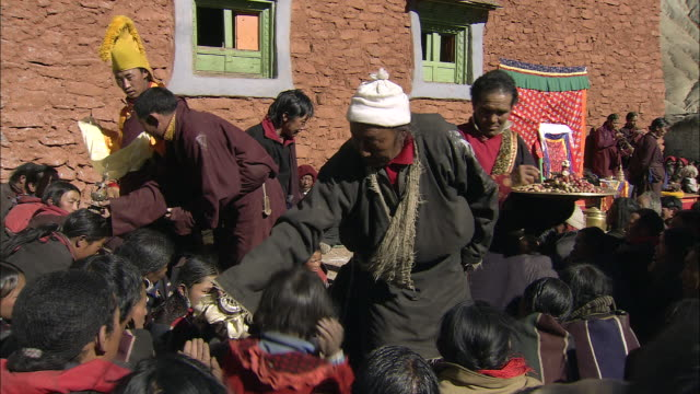 cu lama conducting ceremony at tscheu tibetan buddhist religious  festival / saldang village, high himalayas, upper dolpo near tibetan border, nepal   - religious celebration stock videos & royalty-free footage