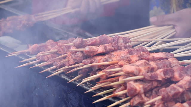 lamb in bamboo stick barbecued on fire