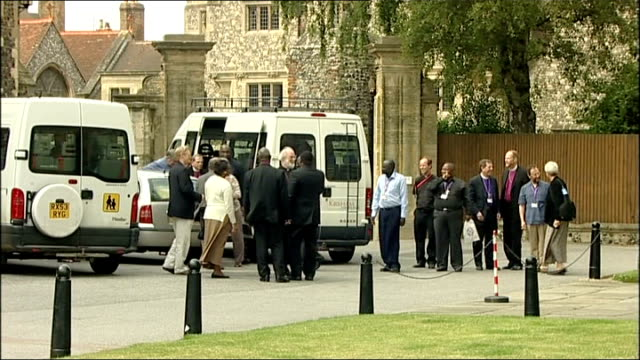 arrivals; england: kent: university of canterbury: ext bishops and guests arriving via minibus / various of dr rowan williams greeting bishops and... - canterbury cathedral stock videos & royalty-free footage