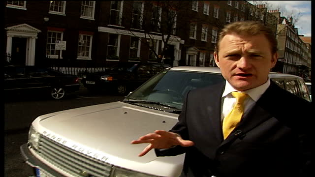 lambeth council change car crushing policy; close up tax disk pull out reporter to camera - ディスク点の映像素材/bロール