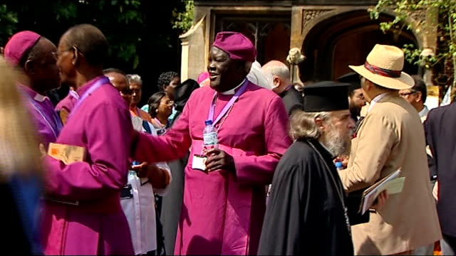 london lambeth palace ext archbishop of canterbury dr rowan williams standing chatting with others and along with bottle of water/ various bishops... - lambeth stock videos & royalty-free footage