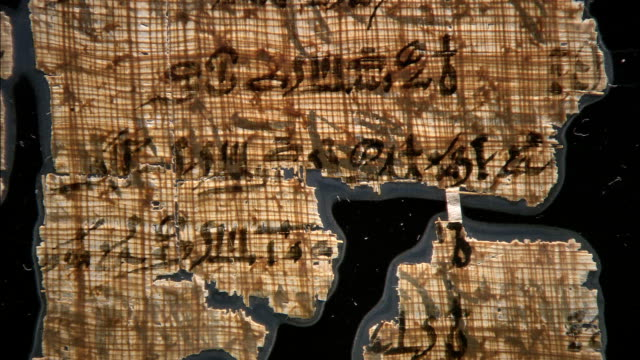 laminate protects ancient egyptian papyrus. - kalligraphieren stock-videos und b-roll-filmmaterial