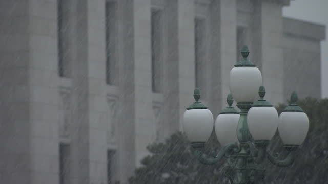 cu, lamp and national diet building in snow, tokyo, japan - parliament building stock videos & royalty-free footage