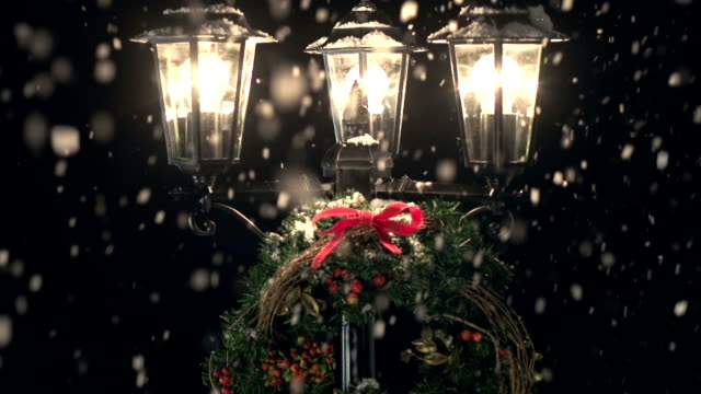 hd crane: lamp post in the snow with christmas wreath - 19th century style stock videos and b-roll footage