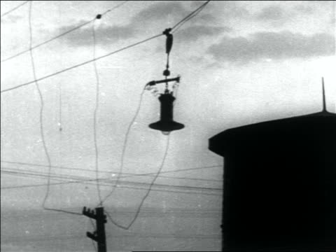 stockvideo's en b-roll-footage met lamp + wires blowing in wind - 1936