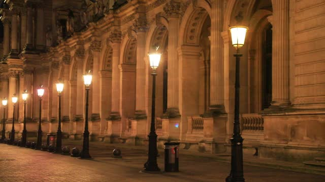 lampposts illuminate the louvre museum building which remain closed because of covid19 on january 7, 2021 in paris, france. unlike the united kingdom... - atmospheric mood stock videos & royalty-free footage
