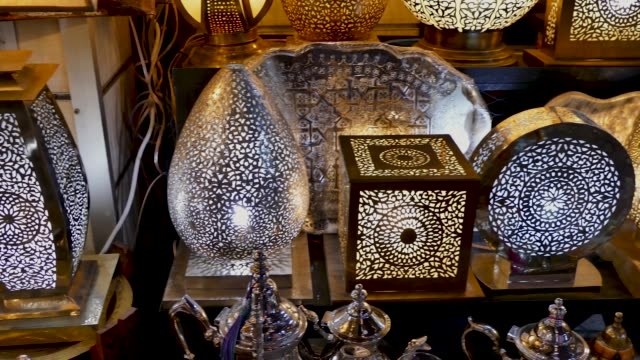 lamps for sale shopping souk jemaa el-fna marrakesh morocco - islam stock videos & royalty-free footage
