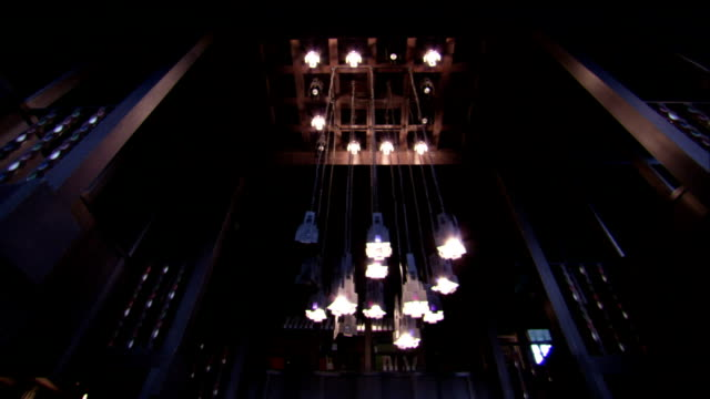 lamps hang from the ceiling of the glasgow school of art. available in hd. - 吊り照明点の映像素材/bロール