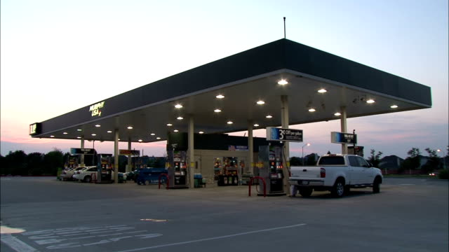led lamps illuminate a gas station. - petrol station stock videos & royalty-free footage