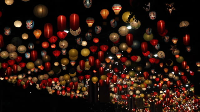 Lamps moving in the wind at night.