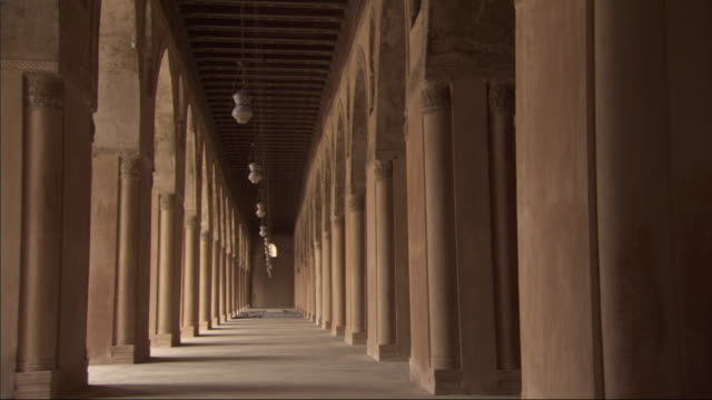 lamps sway between columns at the mosque of ibn tulun. - electric lamp stock videos & royalty-free footage
