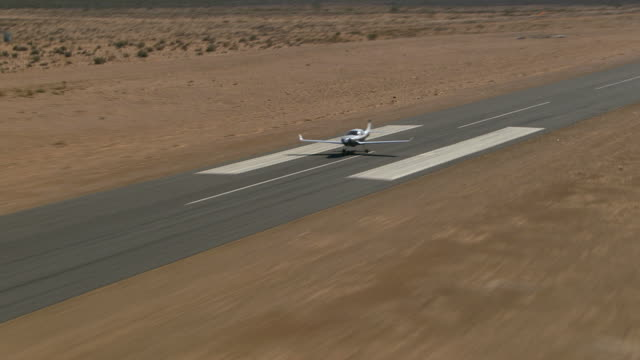 air to air, ts, lancair taking off from runway, mojave desert, california, usa - propeller aeroplane stock videos & royalty-free footage