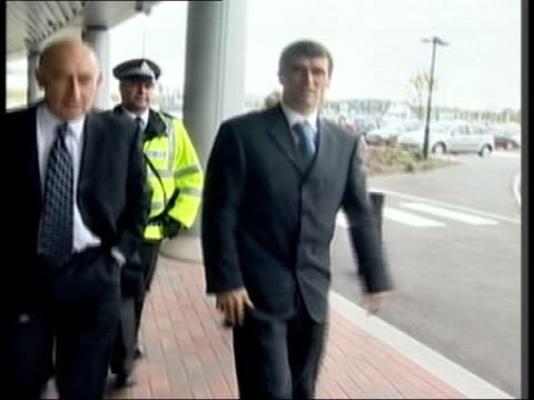 lancashire: bolton: reebok stadium: ext roy keane arriving for hearing into disrepute charges track as into building - lancashire stock videos & royalty-free footage