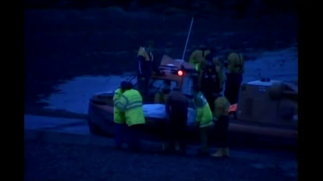 safety concerns tx morecambe bay long shot of covered body on stretcher being carried from rescue boat across beach after group of chinese cockle... - rising tide stock videos & royalty-free footage