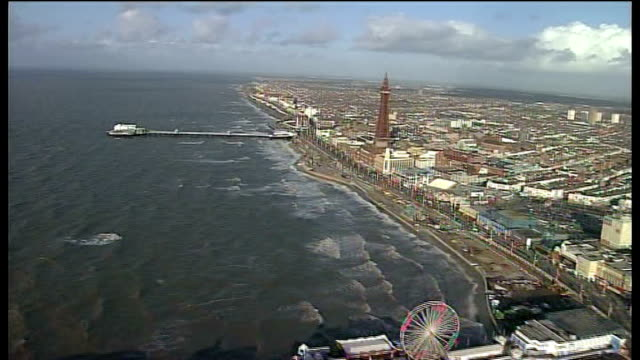 lancashire blackpool pleasure beach air view water at high levels along coastline - blackpool stock videos & royalty-free footage