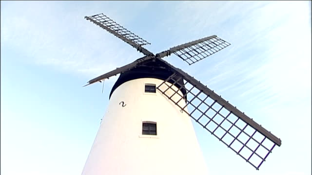 lytham: damaged windmill on sea front - sail torn off in wind blackpool: broken 'blackpool illuminations' signs, some lying on ground - リザムセントアンズ点の映像素材/bロール