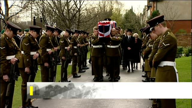 lytham: ext **aston on screen** flag-draped coffin of corporal loren marlton-thomas being carried along by military pallbearers in funeral procession... - リザムセントアンズ点の映像素材/bロール