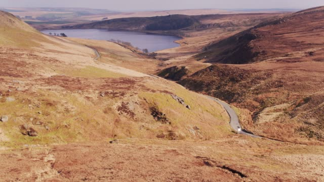 lancashire moorland with reservoir reveal - drone shot - lancashire stock videos and b-roll footage