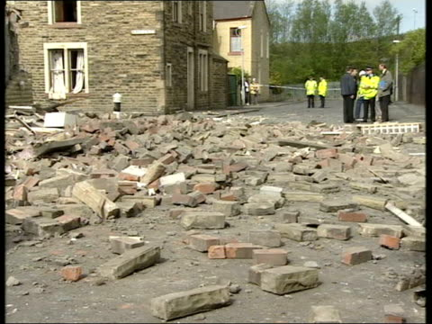 vidéos et rushes de lancashire: nelson: ext gv rubble of house wrecked by gas explosion gv bricks strewn across street gv damaged roof of house - lancashire