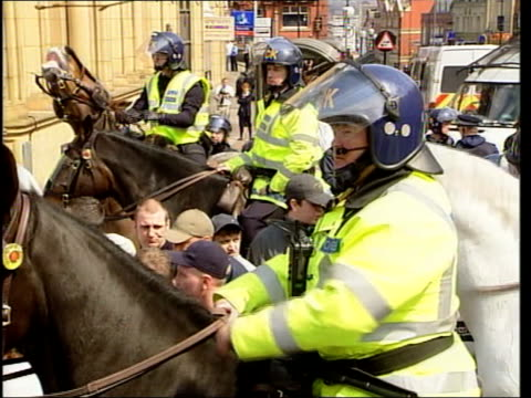 lancashire oldham ext lms police officers in riot gear mounted police officers next protestors police officers shepherding antinazo league protestors... - national front stock videos & royalty-free footage