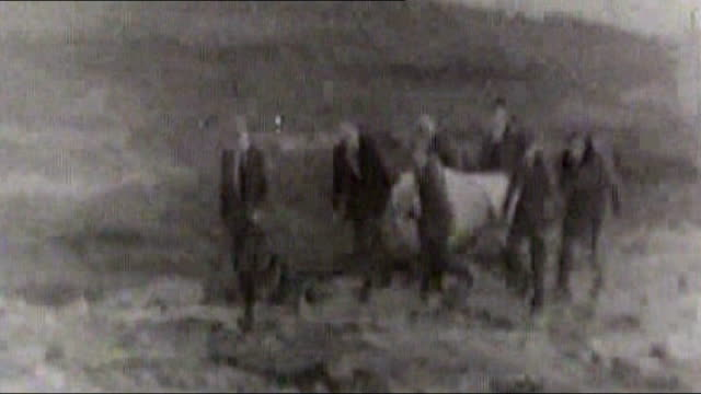 lancashire: saddleworth moor: b/w footage recovered body of one of victims carried along on moor, search team looking for bodies - b rolle stock-videos und b-roll-filmmaterial