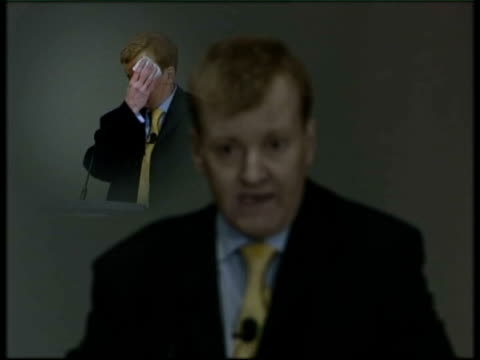 stockvideo's en b-roll-footage met lancashire southport montage liberal party leader charles kennedy mp addressing his party's spring conference and mopping his forehead with a... - southport engeland