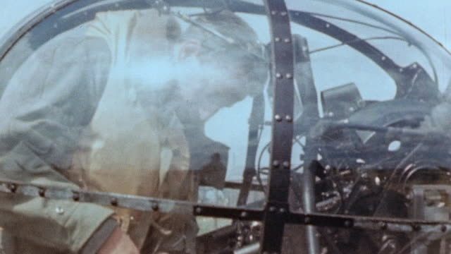 lancaster bomber's dorsal gun turret with gunner settling himself inside the turret and donning flight helmet - lancaster bomber stock videos & royalty-free footage